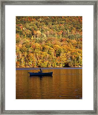 Fisherman In Boat With Fall Foliage Framed Print