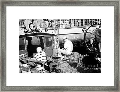 Fisherman Framed Print by John Rizzuto