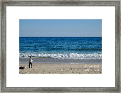 Fisherman On The Beach Framed Print by Angelo DeVal