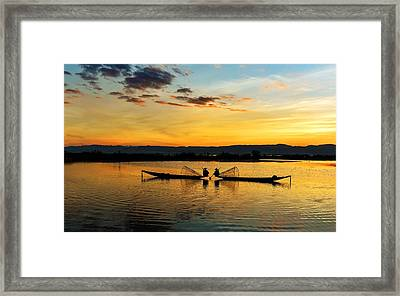 Framed Print featuring the photograph Fisherman On Their Boat by Pradeep Raja Prints