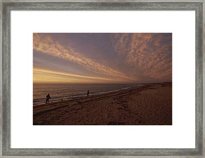 Fishermen Fishing In The Surf At Sunset Framed Print