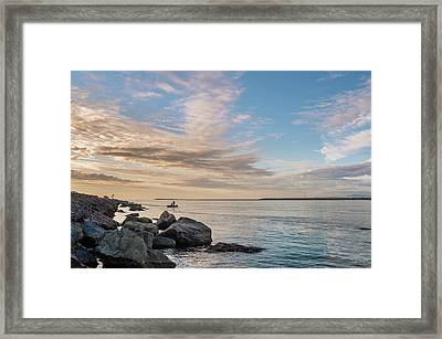 Fishing Along The South Jetty Framed Print by Greg Nyquist