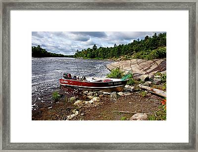 Fishing And Exploring Framed Print