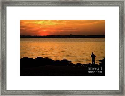Fishing At Sunset Framed Print by Karol Livote