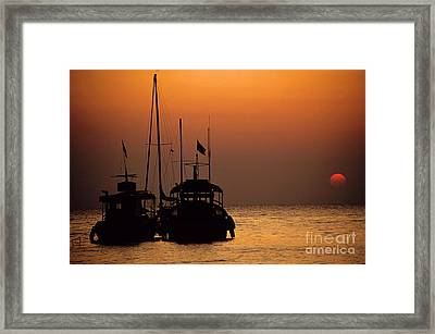 Fishing Boats Together At Sunset Framed Print by Sami Sarkis