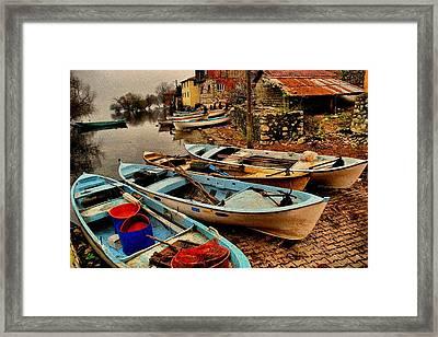 Fishing Canoes Lying Idle L B Framed Print by Gert J Rheeders