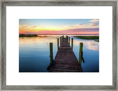 Framed Print featuring the photograph Fishing Dock At Sunrise by Debra and Dave Vanderlaan