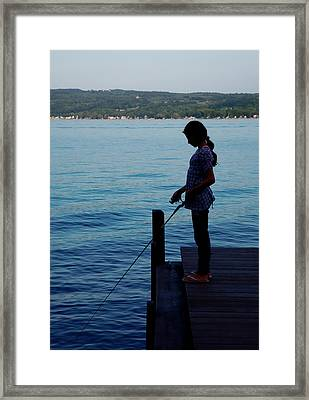 Fishing Girl Framed Print by Steven Ainsworth