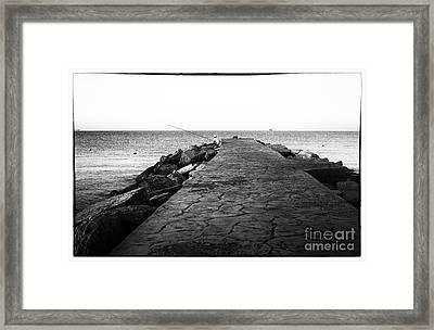 Fishing In Cyprus Framed Print by John Rizzuto