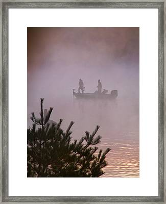 Fishing In The Morning Mist Framed Print by Nancy Griswold