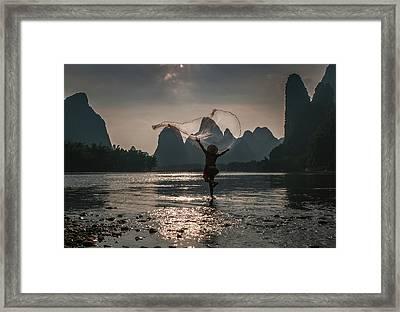 Fisherman Casting A Net. Framed Print