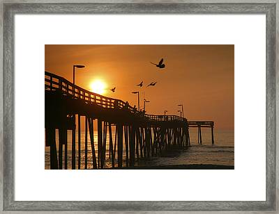 Fishing Pier At Sunrise Framed Print by Steven Ainsworth