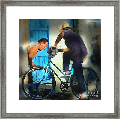 Fixing A Bike - Cuba Framed Print by Bob Salo