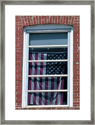 Flag In The Window Framed Print by Rosalie Scanlon