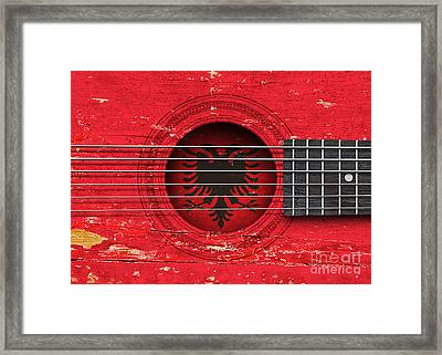 Flag Of Albania On An Old Vintage Acoustic Guitar Framed Print by Jeff Bartels