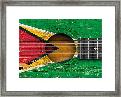 Flag Of Guyana On An Old Vintage Acoustic Guitar Framed Print by Jeff Bartels