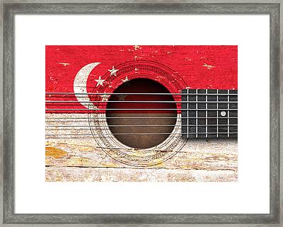 Flag Of Singapore On An Old Vintage Acoustic Guitar Framed Print by Jeff Bartels