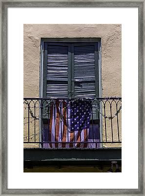 Flag On Wrought Iron Rail Framed Print