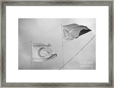 flags of turkey and TRNC turkish republic of northern cyprus flying in the sky above nicosia cyprus Framed Print by Joe Fox