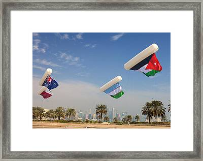 Flags Over Doha Framed Print by Paul Cowan