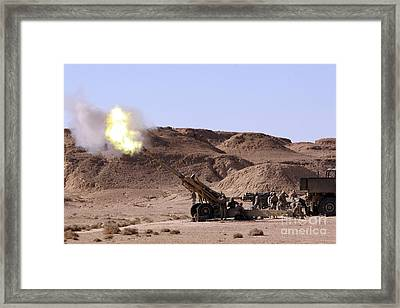 Flame And Smoke Emerge From The Muzzle Framed Print by Stocktrek Images