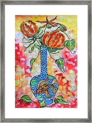 Flame Lily In Goldfish Vase Framed Print