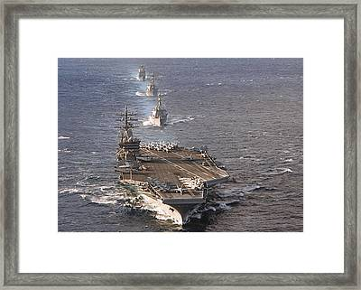 Fleet Of Ships Sail In Formation At Sea Framed Print by Stocktrek Images
