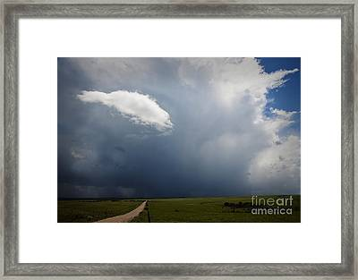 Flint Hills Rain Framed Print by Fred Lassmann