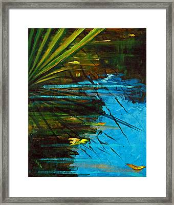 Floating Gold On Reflected Blue Framed Print by Suzanne McKee