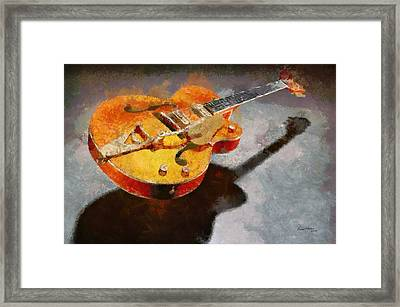 Floating Guitar Framed Print by Russ Harris