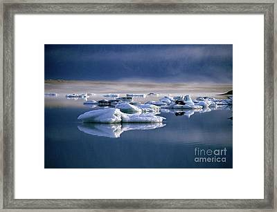 Floating Icebergs Reflected In The Quiet Waters Of Jokulsarlon Framed Print by Sami Sarkis