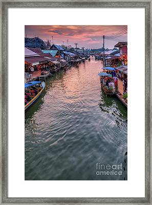 Floating Market Sunset Framed Print by Adrian Evans