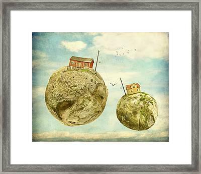 Floating Village Framed Print by Sonya Kanelstrand