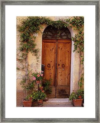 Flowered Tuscan Door Framed Print by Donna Corless
