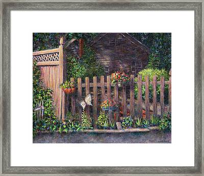 Flowerpots Hanging On A Fence Framed Print by Susan Savad