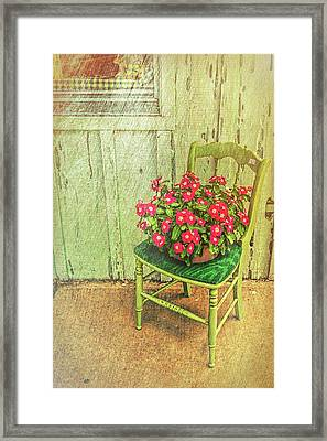 Framed Print featuring the photograph Flowers On Green Chair by Lewis Mann