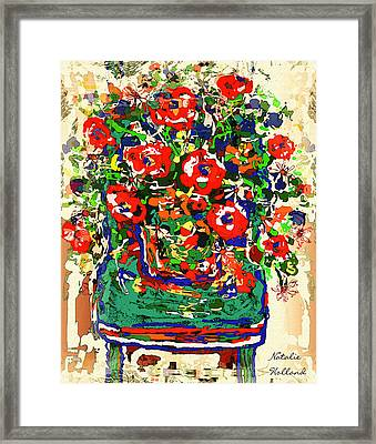 Flowers On Green Chair Framed Print