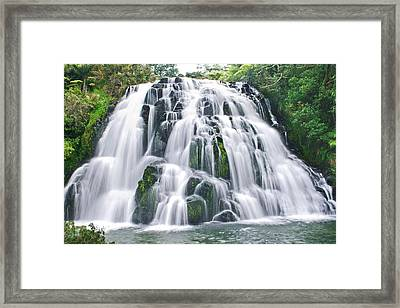 Flowing Ice Framed Print by Andrea Cadwallader
