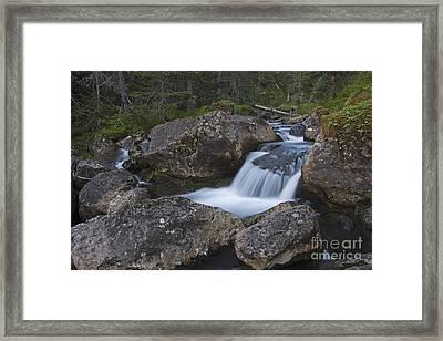 Flowing Through Boulders Framed Print by Tim Grams