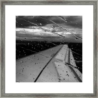 Framed Print featuring the photograph Fly Away On A Rainy Day by Chris Feichtner