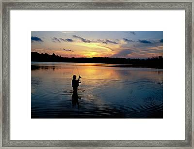 Fly-fisherman Silhouetted By Sunrise Framed Print by Panoramic Images