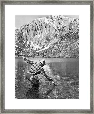 Fly Fishing In A Mountain Lake Framed Print by Underwood Archives