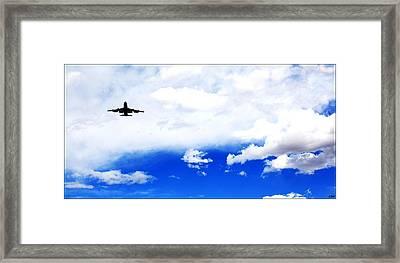 Flying Alone In Blue Sky Framed Print