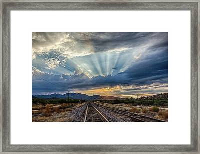 Follow The Rays Framed Print