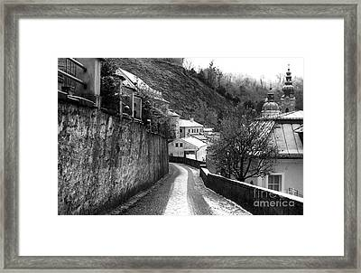 Follow The Snow Path In Salzburg Framed Print by John Rizzuto