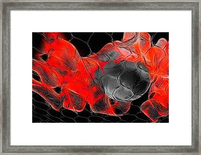 Football Framed Print by Manfred Lutzius