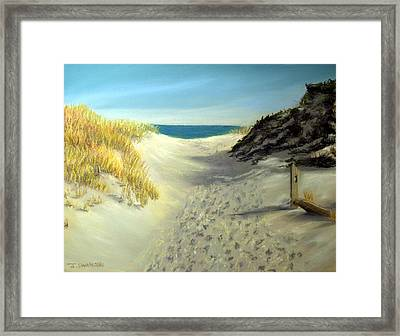 Footprints In The Sand Framed Print by Joan Swanson