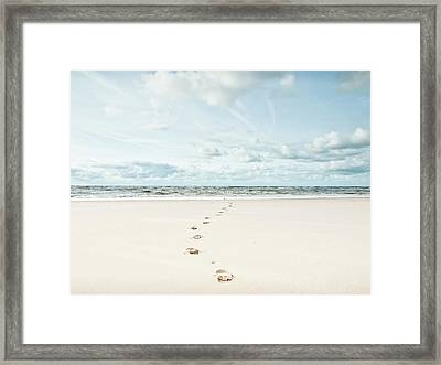 Footprints Leading Into Sea Framed Print by Dune Prints by Peter Holloway