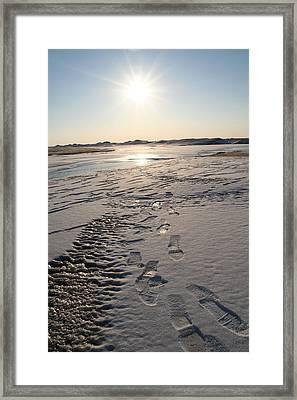 Footsteps In Frozen Landscape Framed Print by Christopher Purcell