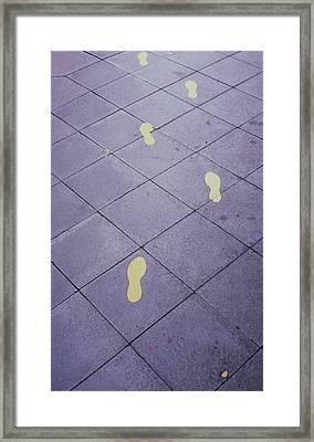 Footsteps On The Street Framed Print